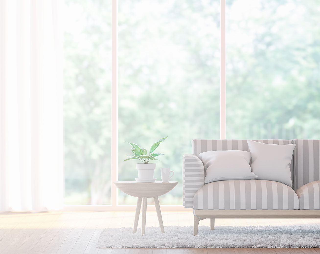 Couch infront of large bay windows